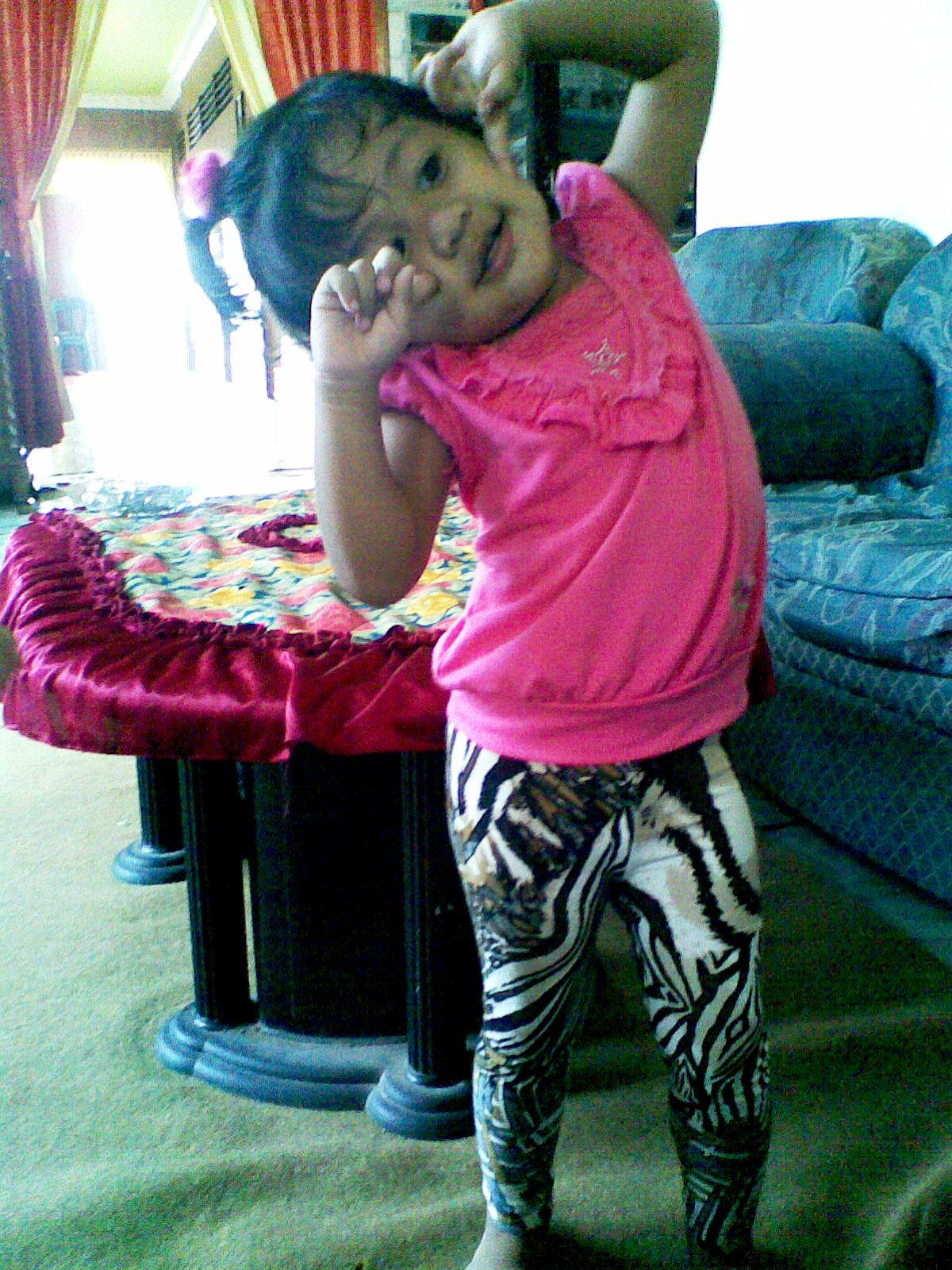 cute with that legging thingy and pose she s only 2 you know