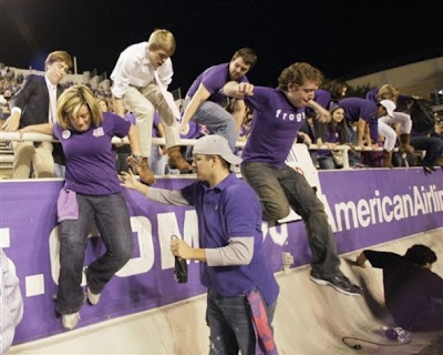 Rush the field in celebration at the end of an ncaa college football
