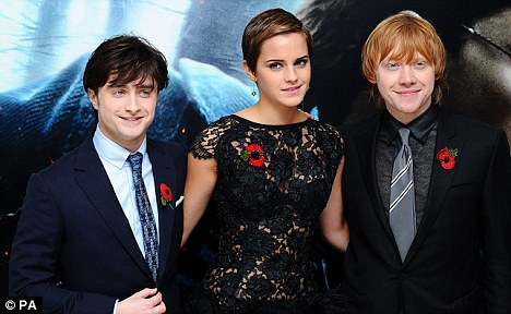 Not so fast: The three stars, pictured at last month's Deathly Hallows: Part
