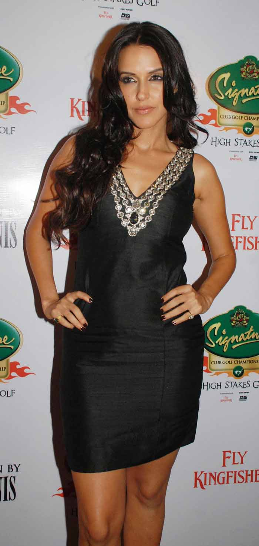 Neha Dhupia in a Short Black Skirt Promoting Signature Club Golf
