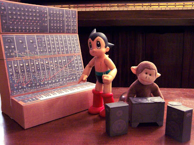 Astro Boy and monkey with papercraft instruments