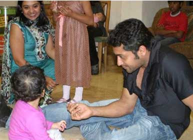 surya jyothika child surya playing with  child family photos