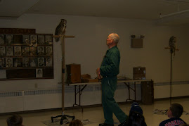 Stan Richardson from Birdsacre at a recent presentation of owls at the Brewer Auditorium.