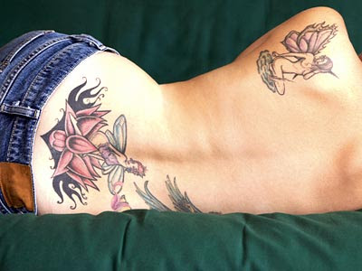 small lower back tattoos for girls. small lower ack tattoos