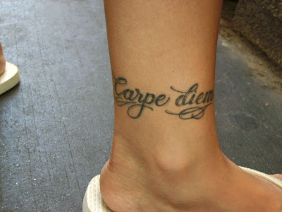 "Latin for ""seize the day,"" is among the most popular ""word tattoos,"" and"