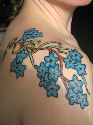And what Jenny sent me was a breathtaking floral tattoo that is simply