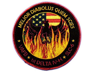 nrol-49 mission patch: space glyphs