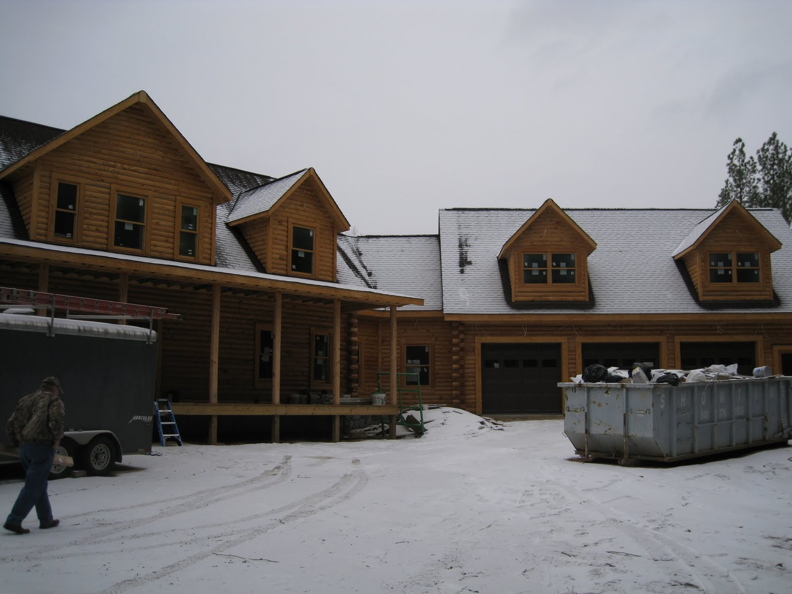Construction of our log home: Paint & Garage Doors