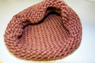 This cocoon is was made with a tighter knit pattern.