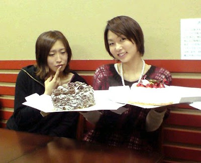 Nazuka Kaori (left) and Yuuko, working on Christmas Eve, 2008