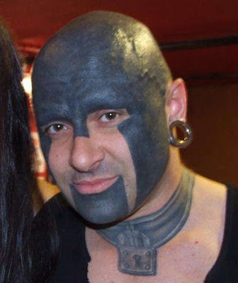 Here are a couple of new facial tattoos I found that I haven't seen before.