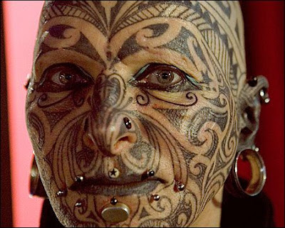 tattooed faces. tattooed faces.