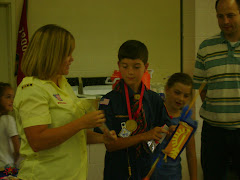 Logan receiving his Scouting Arrow of Light