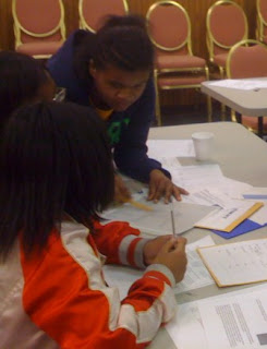 Students in Laurel, MD analyzing evidence as part of