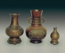 Thee vessels, bronze