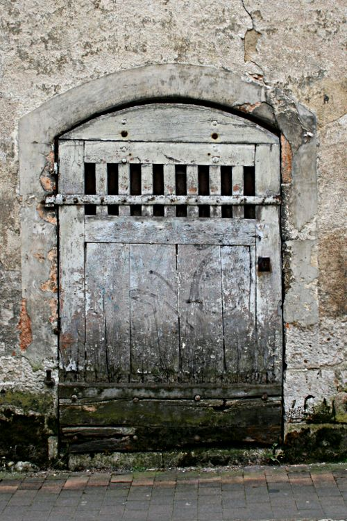 old wooden doorway in a stone wall