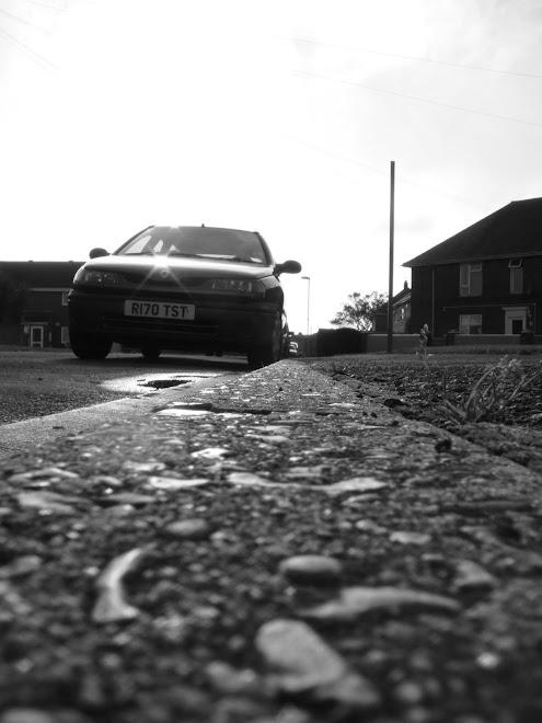 CAR IN A KERB