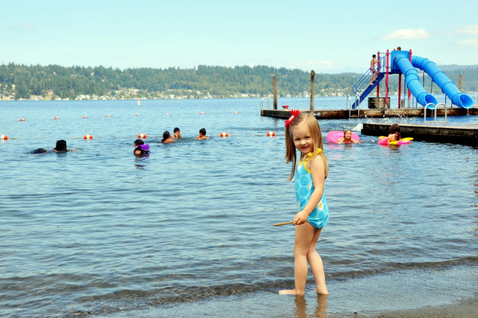 Kids Swimming In A Lake veater family: summertime and swimsuits!