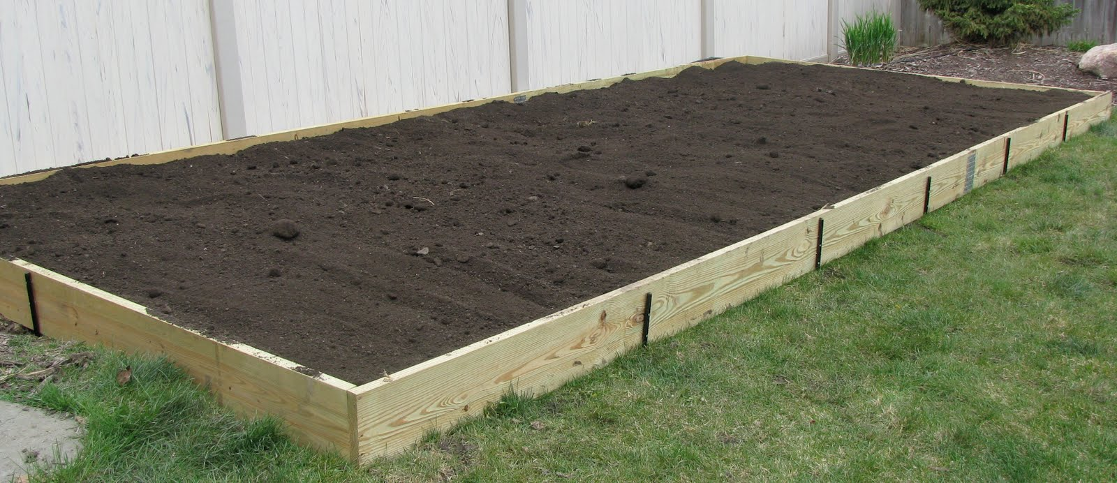 Building raised vegetable garden beds with cheapest and for Garden construction