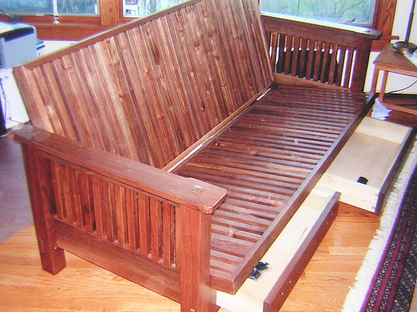 Custom designed and built Craftman's style futon built of walnut milled from client's tree.