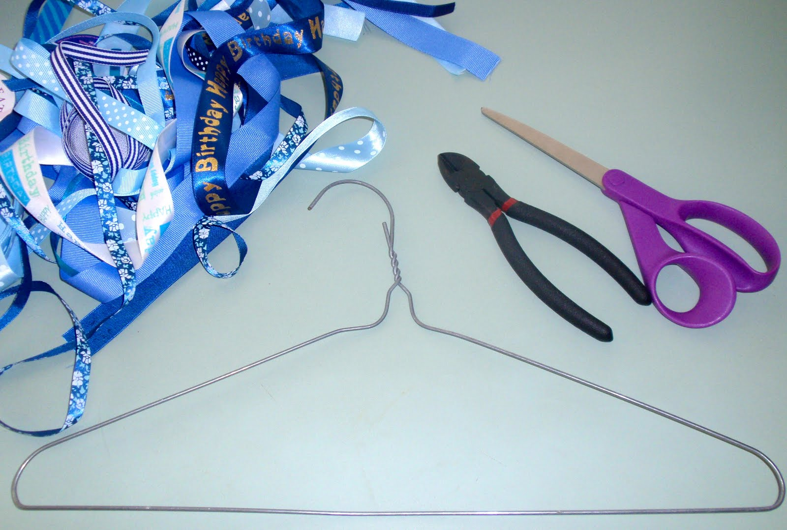 Ribbon wreath tutorial on wire hanger - Diy Tutorial From A Catch My Party Member How To Make A Ribbon Wreath