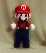Amigurumi Mario from the Mario Bros Nintendo game. He is greatly done.