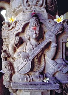 Sarasawati stone carving om Ubud villa hotel Bali