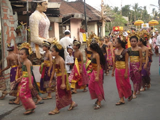 procession in kutuh a small village in the rice fields near our villa hotel in Ubud