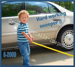 little boy helps sweep with big broom photo image