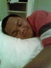 my bro sleep and smile...lol