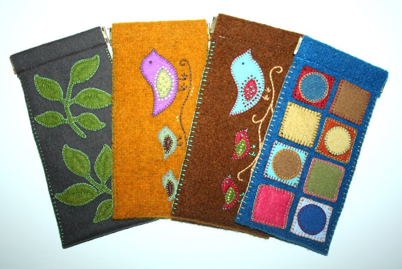 assorted felt eyeglass cases with leaves, birds, and geometric shapes