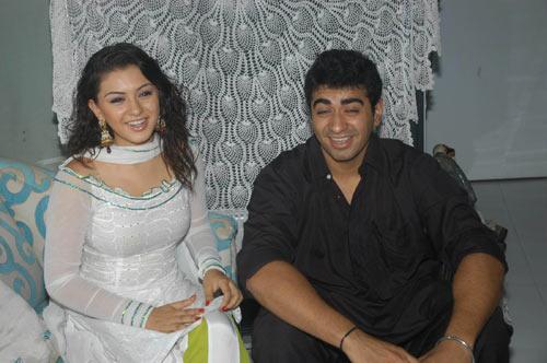Hansika Motwani in a White Tight tranparent Shirt Salwar tying Rakhi