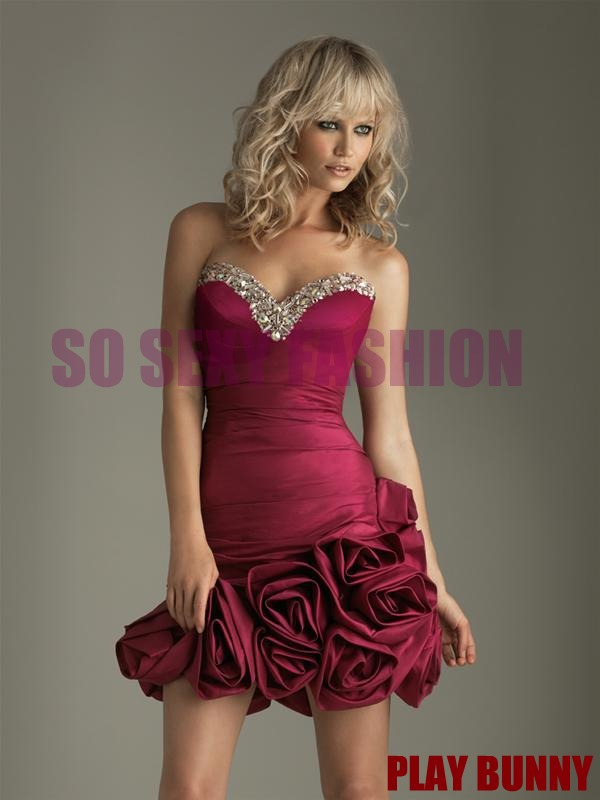 This dress is from a TOP Designer 2011 Collection. Colors: Black, Fuchsia