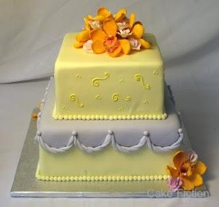 Cymbidium orchids and sweet peas graduation cake