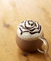 Hot chocolate with cream and chocolate sauce