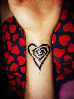 heart tattoos for women. dresses heart tattoos on foot.