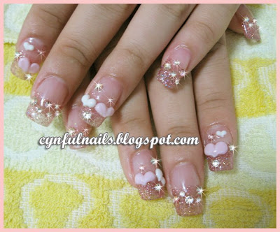 Pink Glittery Acrylic Extension With Baby And White Puffy Hearts Not Forgetting Crystals