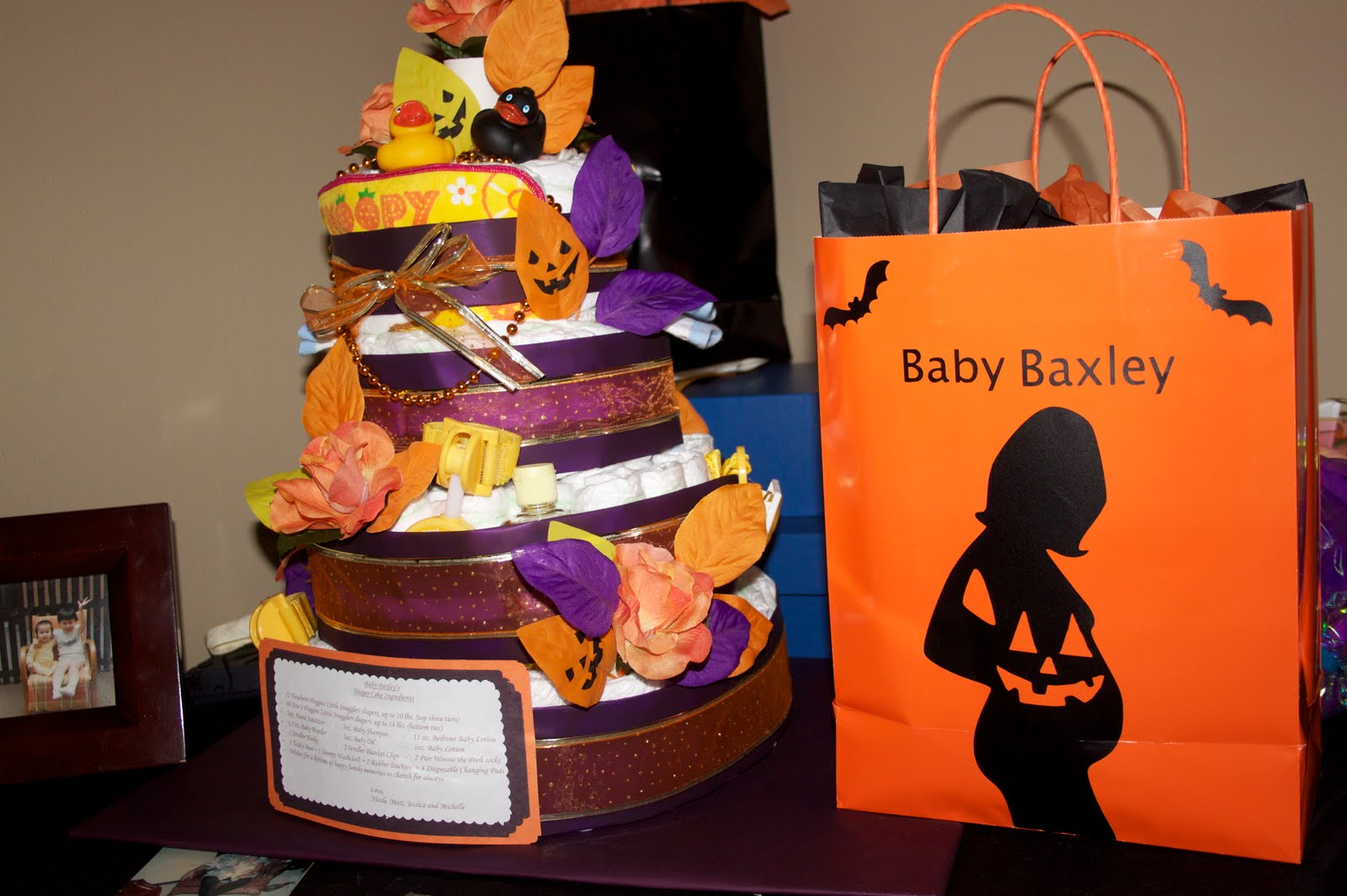 a friend made this beautiful diaper cake how cute the bag is from me thanks to my cricut for decorating it
