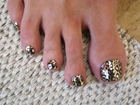 I took a picture of this girl's toe nails, she had a leopard minx design on.