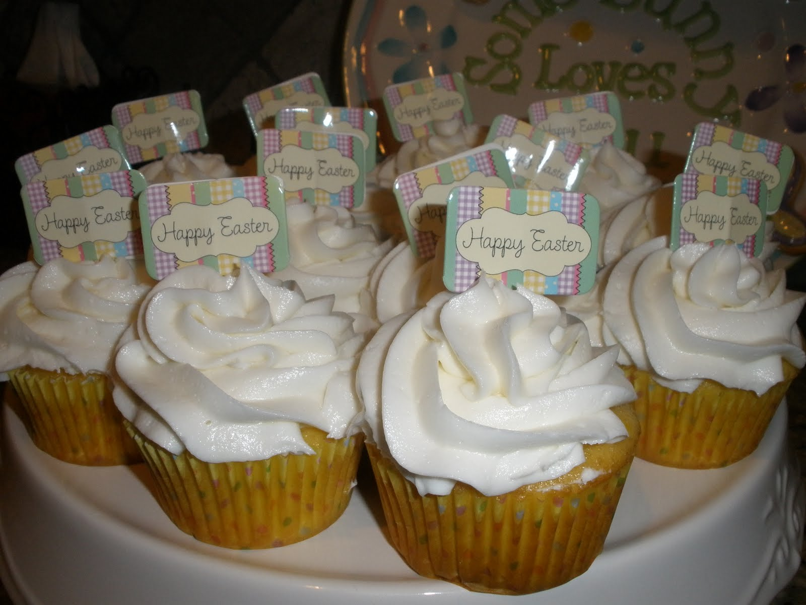 yellow cupcakes filled with fudge icing and topped with almond ...