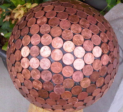 Bowling ball yard art made with pennies - via houseofhawthornes.com
