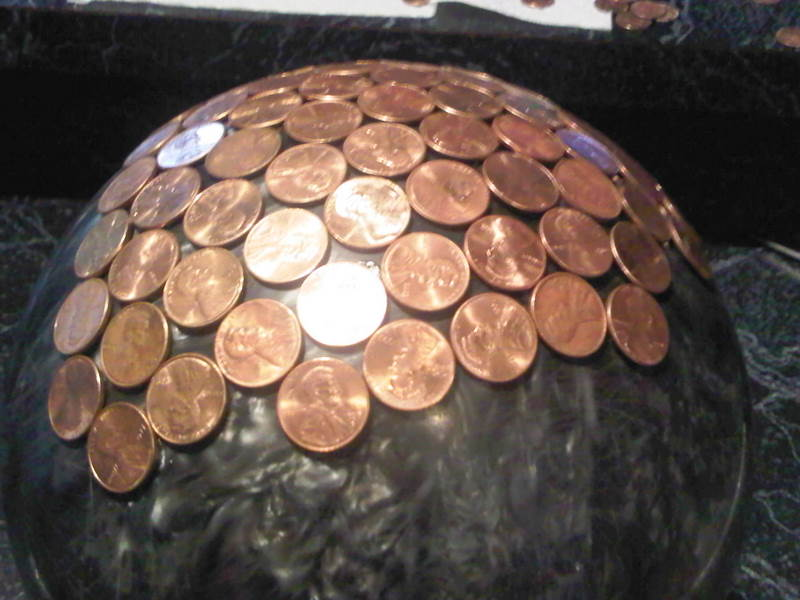 How to make a penny bowling ball house of hawthornes how to make a penny bowling ball fun and unique yard art for your garden solutioingenieria Image collections