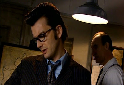 The Doctor and Detective Inspector Bishop prepare to use the dome of silence