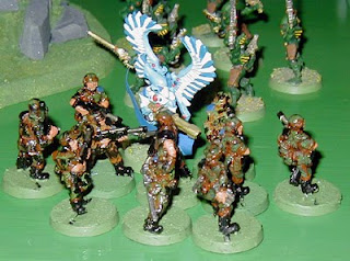 The Swooping Hawk Exarch comes under attack by the Imperial Guard reinforcements