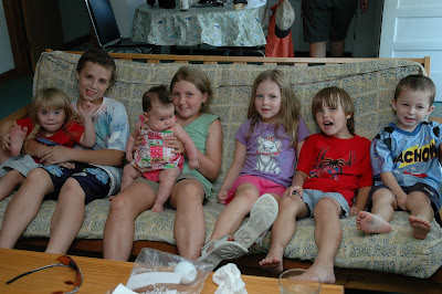 All of Grammy Donna's grandchildren on the couch