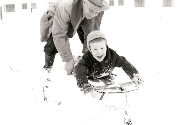 John is taking Johnny for a sledding lesson.