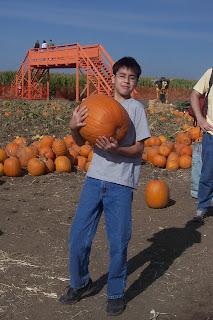 boy with pumpkin