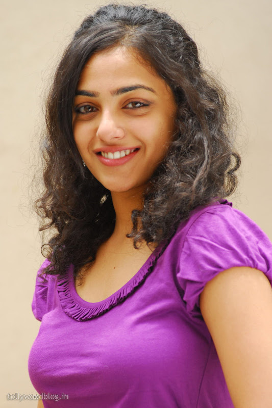Nitya Menon Cute Looking Stills from Ala Modalaindhi Telugu Movie gallery pictures