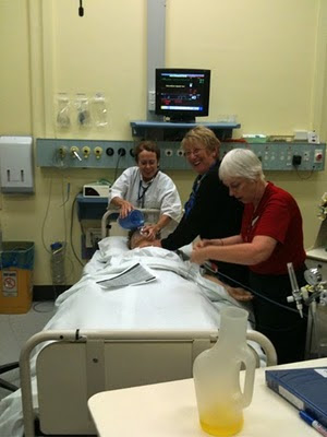 Employees of St. Vincent's Hospital practice saving a dummy from cardiac arrest.