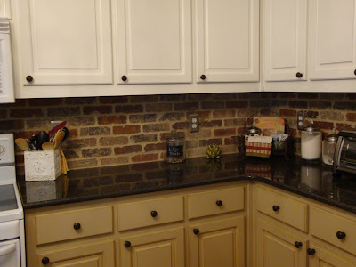 little piece of heaven a surprise brick backsplash and some curtains